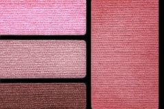 Primo piano della tavolozza di colore degli accessori di trucco Fotografie Stock Libere da Diritti