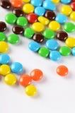 Primo piano delle caramelle di cioccolato variopinte del mucchio Fotografia Stock Libera da Diritti
