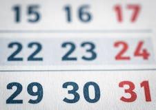 Primo piano delle date alla pagina del calendario Immagine Stock