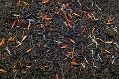 Primo piano delle foglie di tè nere Fotografia Stock