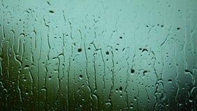 Primo piano delle gocce di acqua su vetro come fondo Fotografia Stock