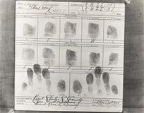 Primo piano delle impronte digitali della persona prese alla questura Immagini Stock