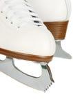 Primo piano delle lamierine dei pattini di ghiaccio. Immagini Stock
