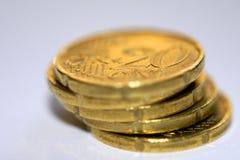 Primo piano delle monete di oro Fotografie Stock