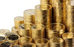 Primo piano delle monete dorate Fotografie Stock