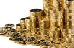 Primo piano delle monete dorate Immagini Stock