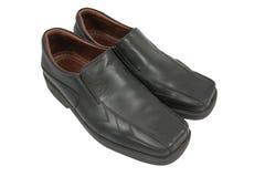 Primo piano delle scarpe degli uomini eleganti su fondo bianco Fotografia Stock