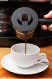 Primo piano di caffè in tazza Fotografia Stock