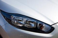Primo piano di Front Head Lamp lasciato veicolo Fotografia Stock