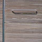 primo piano di legno moderno della porta Fotografia Stock