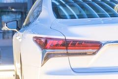 Primo piano di luce posteriore dell'automobile bianca moderna Fotografia Stock Libera da Diritti