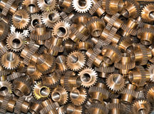 Primo piano di molti ingranaggi del metallo Fotografie Stock Libere da Diritti