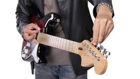 Primo piano di sintonia della chitarra Fotografie Stock