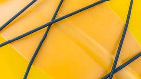 Primo piano di struttura gialla del kajak, struttura di plastica Fotografia Stock