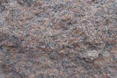 Primo piano di superficie irregolare della pietra rosa del granito Fotografia Stock Libera da Diritti