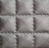 Primo piano di tessuto imbottito Fotografia Stock