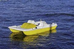 Primo piano di una barca gialla del pedale in Sardegna Italia immagini stock