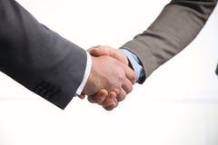 Primo piano di una stretta di mano di affari, su bianco Immagine Stock Libera da Diritti