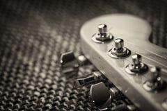 Primo piano elettrico della testa motrice della chitarra Fotografia Stock Libera da Diritti