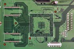 Primo piano elettronico di colore verde del circuito Immagini Stock