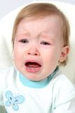 Primo piano gridante della neonata Fotografia Stock