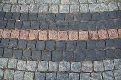 Primo piano multicolore della pavimentazione delle pietre Immagini Stock