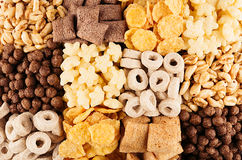 Primo piano nei quadrati, fondo della raccolta dei fiocchi di mais dei cereali Vista superiore Fotografie Stock Libere da Diritti