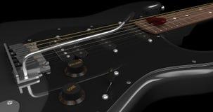 Primo piano nero della chitarra elettrica Immagini Stock