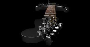 Primo piano nero della testa motrice della chitarra elettrica Immagini Stock Libere da Diritti