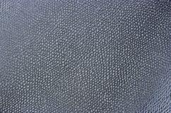 Primo piano nero di cuoio sintetico, struttura, fondo immagine stock