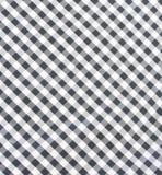 Primo piano a quadretti in bianco e nero del tessuto fotografie stock