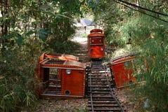 Primo piano rosso abbandonato di giro del treno Immagini Stock Libere da Diritti