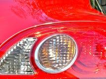Primo piano rosso dell'automobile Immagini Stock