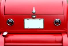 Primo piano rosso dell'automobile dell'annata Fotografia Stock