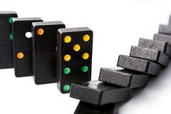 Domino diritto e caduto Fotografia Stock