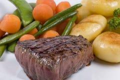 Primo piano sugoso della bistecca Fotografia Stock