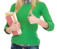 Primo piano sulla ragazza dello studente che mostra i pollici su Immagini Stock Libere da Diritti