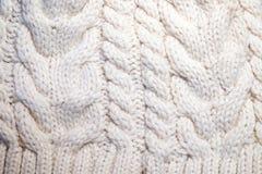 Primo piano tricottante bianco di struttura della lana immagine stock libera da diritti