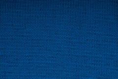 Primo piano tricottato blu di struttura della tela Priorità bassa della sfuocatura fotografia stock