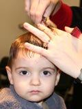 Primo taglio dei capelli Fotografia Stock