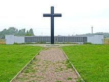PRIMORSK, RUSSIA. A memorial wall and a memorable cross at the German military cemetery of World War II. PRIMORSK, RUSSIA - AUGUST 21, 2012: A memorial wall and royalty free stock photos