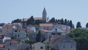 Primosten church tower with clock stock video