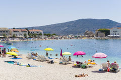 Primosten, Croatia, August 5 2017. People sunbathing on beautiful beach, Nice warm summer day with blue sky and ocean royalty free stock photos