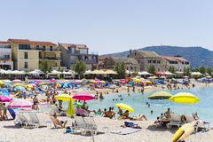 Primosten, Croatia, August 5 2017. People sunbathing on beautiful beach, Nice warm summer day with blue sky and ocean Royalty Free Stock Photography