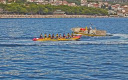 Primosten, Croatia - tourists on a banana boat dragged by motor Royalty Free Stock Images