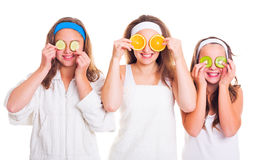 Primping girls having fun with fruit slices Stock Photography