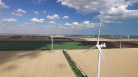 Primposad, Ukraine - July2017: Rotating wind turbines producing alternative energy under the clouds. Aerial survey. Primposad, Ukraine - July2017: Rotating wind stock video