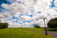 Primrose Hill in London. Primrose Hill on a beautiful day with clouds. The clouds seemed to be caught in the hand royalty free stock images