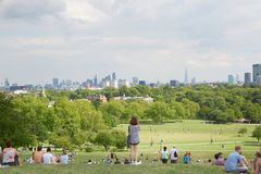 Primrose hill top with London city view and people Royalty Free Stock Photos