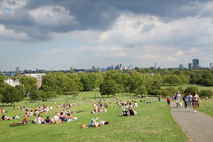 Primrose hill top with London city view and people in the park Royalty Free Stock Photos